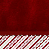 Red and White Striped Candy Cane Striped Background with Red Plu Royalty Free Stock Photo