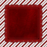 Red and White Striped Candy Cane Striped Background with Red Plu Stock Image
