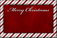 Red and White Striped Candy Cane Striped Background with Red Plu Royalty Free Stock Image