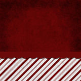 Red and White Striped Candy Cane Striped Grunge Background. With top copy space for your message Stock Image