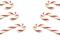 Several candy canes lined up on both sides of the picture. Isolated on white. stock photo