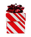 Red and white striped Christmas gift box with bow isolated Royalty Free Stock Image