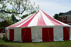 Red and white striped circus tent. A bright red and white striped tent may be seen at a birthday party,  concert, or circus Royalty Free Stock Images