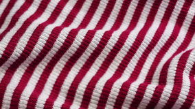 Red and white striped cloth background stock footage