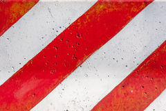 Red and white striped concrete road barrier texture. Stock Photos