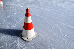 Red white striped cones on the rink Royalty Free Stock Photos