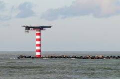 Lighthouse with heliplatform at the North Sea near the entrance of the Port of Rotterdam Royalty Free Stock Photography