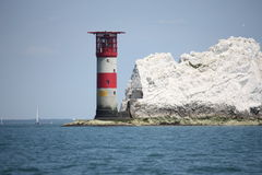 The red and white striped lighthouse at the needles in the solent Royalty Free Stock Images