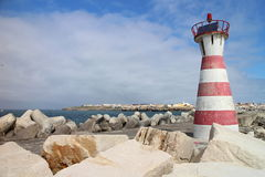 Red and white striped lighthouse in Peniche Royalty Free Stock Images