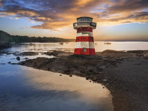 Red and white striped lighthouse. At sunset, located in Maine, USA Royalty Free Stock Image