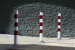 Red and white striped poles Royalty Free Stock Photos