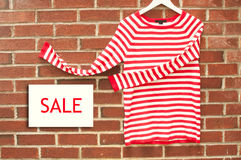 Red and white striped shirt with sale sign Royalty Free Stock Image