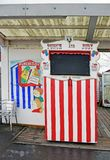 A red and white Punch and Judy Stand. A red and white striped stand which is used for Puppet shows to keep children amused , the Punch and Judy stand is on Herne stock photography