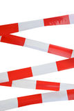 Red and white striped tape Royalty Free Stock Images