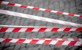 Red and white striped tapes. Restricted area border. Red and white striped tapes Royalty Free Stock Images