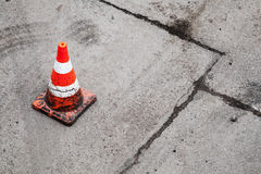 Red and white striped warning cone Stock Image