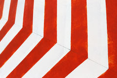 Red and white stripes closeup background. Painted concrete wall Stock Photography