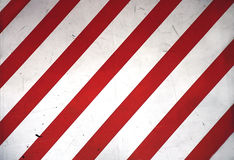Red and white stripes. Diagonal red and white stripes,caution sign Royalty Free Stock Photography