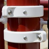 Red and White Structure. Stainless steel bolt and washer hardware connecting red and white structure Stock Photography
