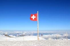 Red-white Swiss flag marks the Jungfraujoch Stock Images