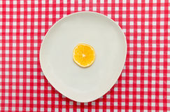 Red and White table cloth with white lemon. Slice Royalty Free Stock Photography