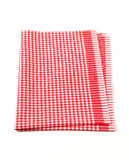 Red and white table linen. Isolated on white Royalty Free Stock Photography