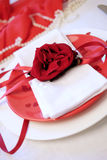 Red and white table setting for diner anniversary celebration Royalty Free Stock Photos