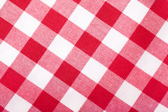 Red and white tablecloth. Closeup view of checked with red and white tablecloth Stock Image