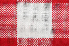 Red and white tablecloth macro. With a single white square and the surrounding red areas Royalty Free Stock Images