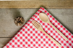 Red and white tablecloth, wooden spoons on wood table Stock Photos