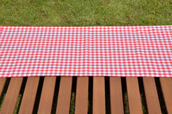 Red and white tablecloth and wooden surface Stock Photos