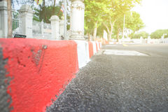 Red and white tap. On the pavement for traffic sign for no parking or stopping a car Stock Photography