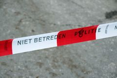 Red white tape with dutch text Niet Betreden, Politie which means no trespassing police to be used by the police in the Netherland. S stock images