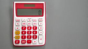 Ten Digits Accounting Calculator with Empty Space on the Right. Red and White Ten Digits Accounting Calculator with Empty Space on the Right Royalty Free Stock Photo