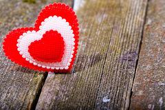 Red-white textile heart on old gray boards Royalty Free Stock Photography