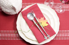 Red and white theme festive fine dining table setting Royalty Free Stock Photos