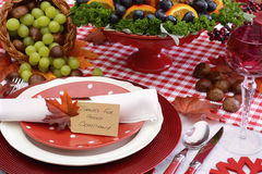 Red and white theme Thanksgiving table. Red and white theme Thanksgiving table with individual place setting, food and cornucopia, closeup on Thanks for Good Royalty Free Stock Photography