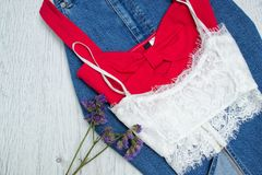 Red and white top on a denim skirt. Close up Stock Photo