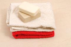 Red and white towels and honey Stock Images