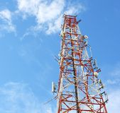 Red and white tower of communications Stock Image