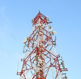 Red and white tower of communications Royalty Free Stock Photography