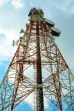 Red and white tower of communications with with a lot of differe Royalty Free Stock Image