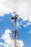 Red and white tower of communications with a lot of different an Stock Photo