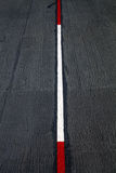 Red and white traffic lines. Red and white traffic lines on Asphalt road stock photography
