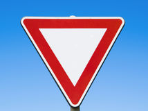 Red and white traffic sign on blue sky Stock Photo