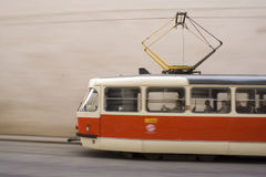 Red and white tramway in prague II. Red and white tramway in prague moving fast Stock Photos