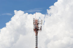 The red white transmission tower. With blue sky background royalty free stock image