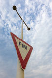 Red and white triangle sign post with FMI, Memory Park