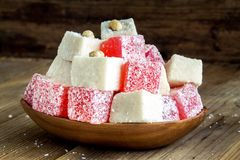 Red and white Turkish Delight with coconut in a wooden bowl Stock Photo