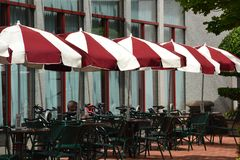 Red/White umbrellas and outside tables in Portland, Oregon. These are red & white umbrellas and outdoor cafe tables in downtown Portland, Oregon royalty free stock photos